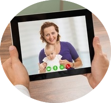dr talking to mom and baby on ipad
